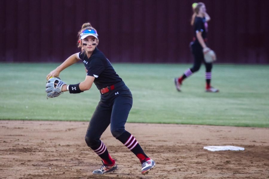 Freshmen shortstop no. 5 Skylar Rucker throws the ball to X to warm up before the next inning. The Leopards will play in the regional semi-finals on Wednesday and Friday.