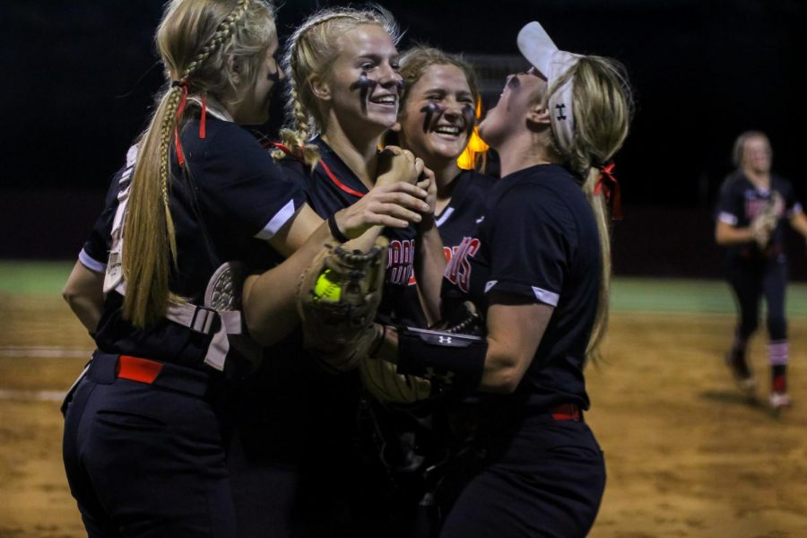 Sophomore catcher no. 3 Sydney Bardwell, sophomore pitcher no. 7 Jade Owens, junior third baseman no. 16 Emma Bittlestone, and senior third baseman no. 4 Holly Massey celebrate after winning the first game of the three-game series. The Leopards won in the first two games of the series.