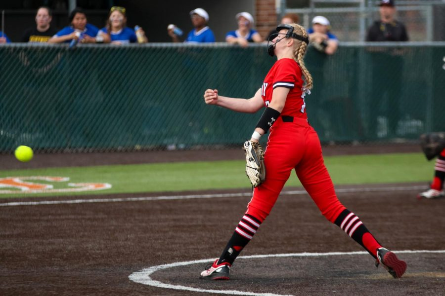 Sophomore pitcher no. 7 Jade Owens throws the ball to the Wildcat hitter. Owens was named the Dallas Morning News Softball Player of the Week after these games.