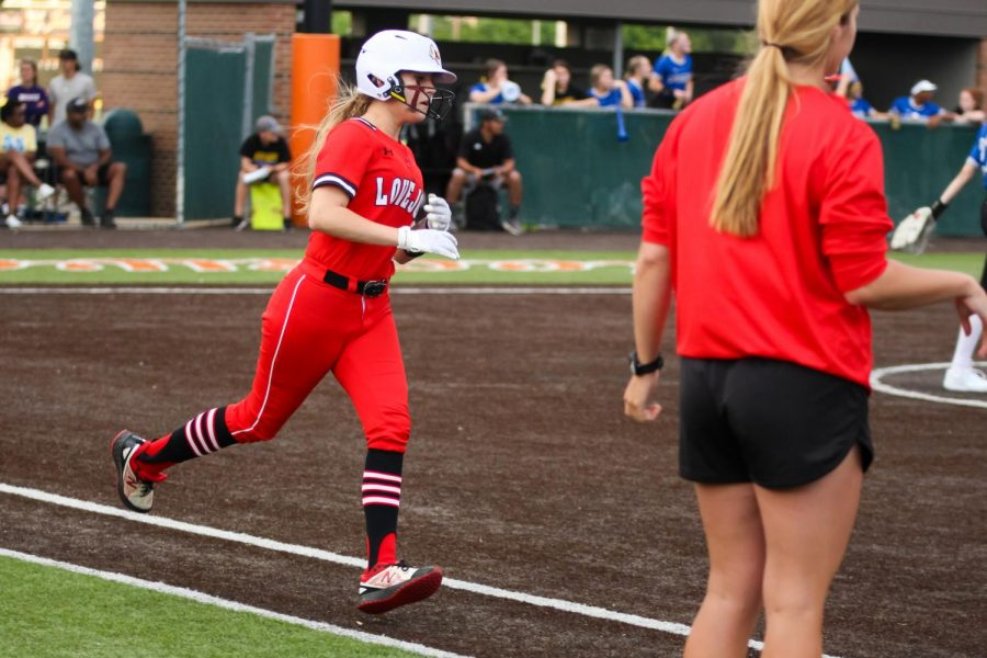 Sophomore catcher no. 3 Sydney Bardwell runs to first after hitting. Bardwell scored one run in the first game.
