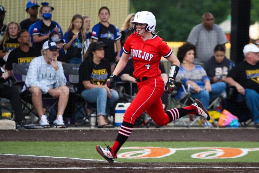 Senior first baseman no. 4 Holly Massey runs to home plate. Massey's run brought the score to 4-0.