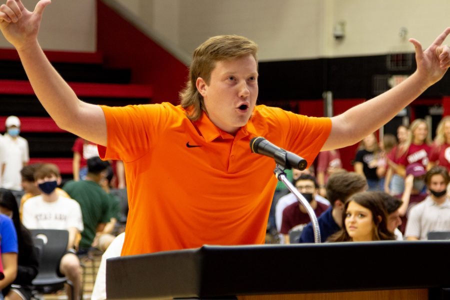 Senior Gavin Burkhardt puts his hands in