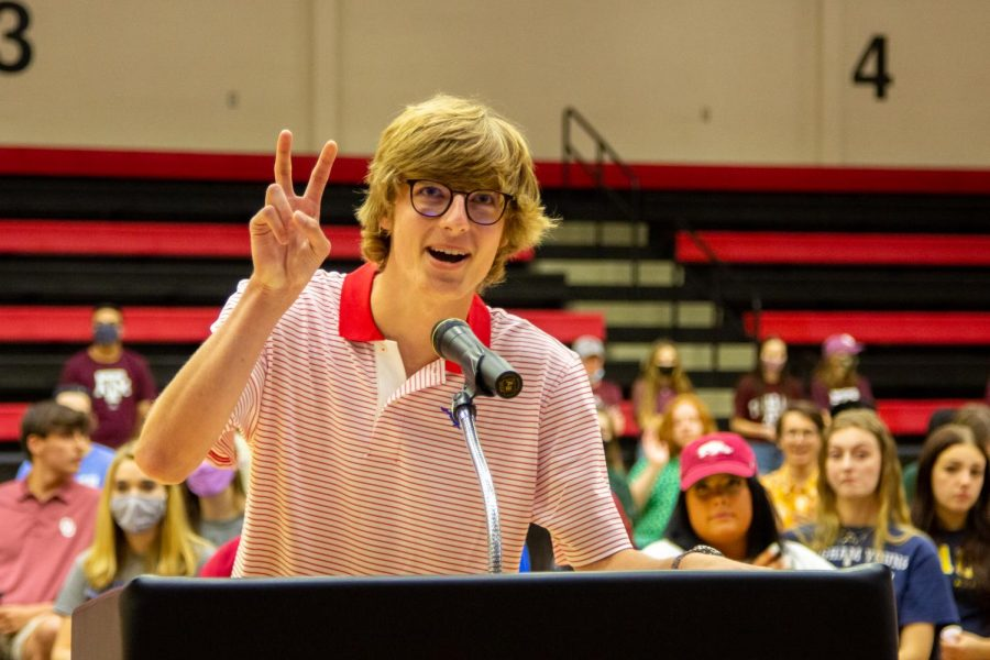 Senior Braden Schlimme does the pony up hand sign for Southern Methodist University. Schlimme will be majoring in business finance.
