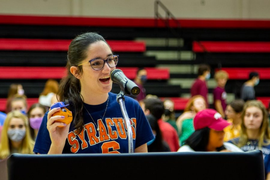 Senior Amelia Flinchbaugh holds her orange. Flinchbaugh will be attending Syracuse University in the fall to study graphic design.