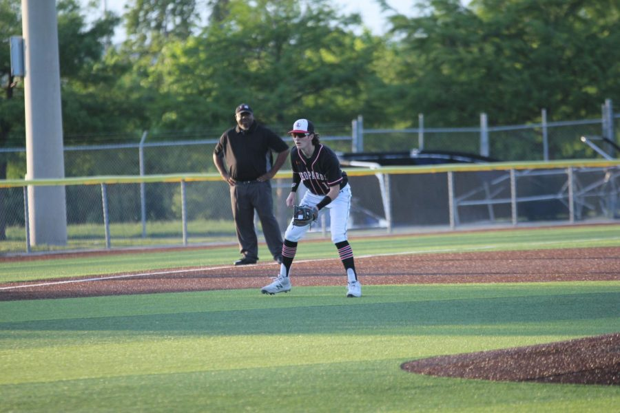 Senior third baseman no. 15 Dylan Collins gets ready to catch the ball. The Leopards allowed no runs to be scored by Hillcrest.