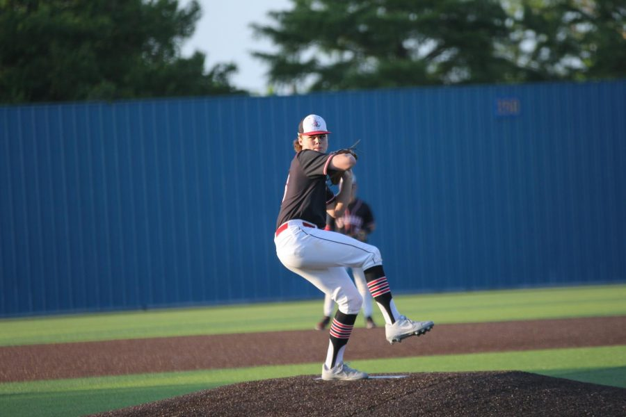 Junior pitcher no. 16 Brandt Corely prepares to throw the ball. Corely allowed no runs to be scored by Hillcrest.