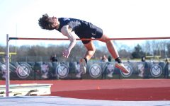 Freshman Colston Adamson clears the high jump bar at districts. Adamson plans to continue track in college.