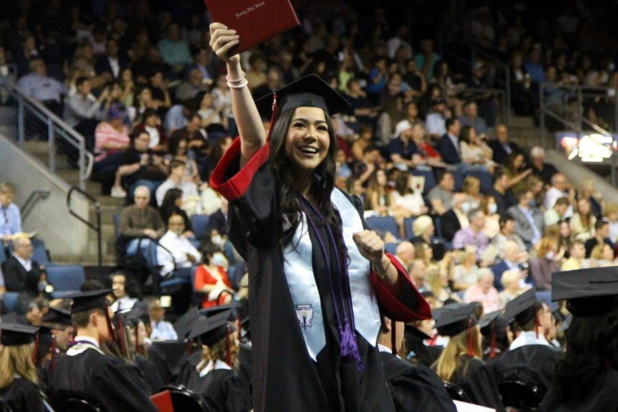 Graduate Delaney Walker celebrates while looking at family. Walker plans to dance for the Oklahoma City Unversity.