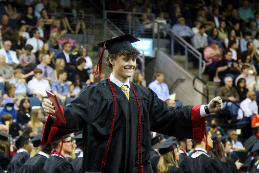 Graduate Jackson Willard celebrates graduating as he walks to his seat. Willard will be attending the University of Oklahoma.