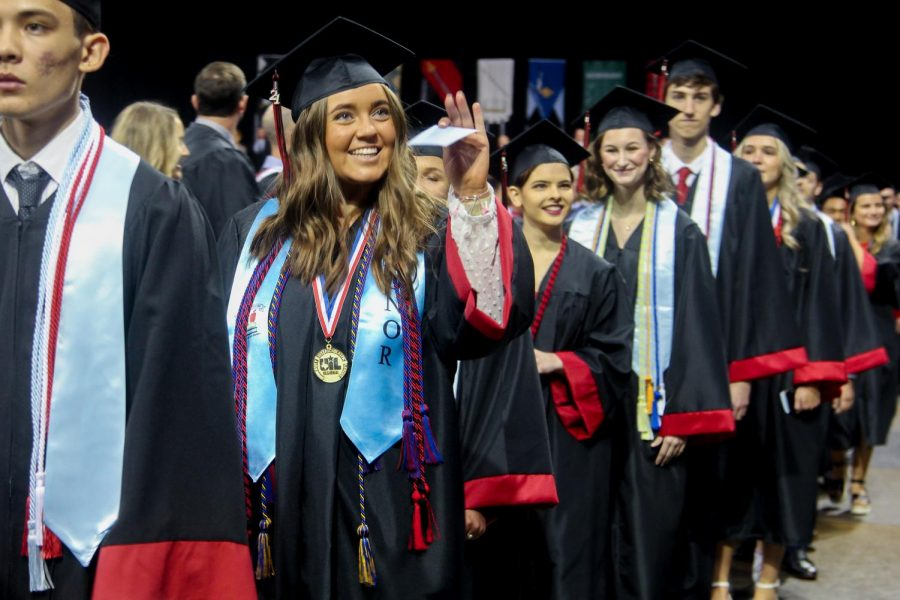 Graduate Chelby Inman waves to family. Graduation took place this past Saturday.