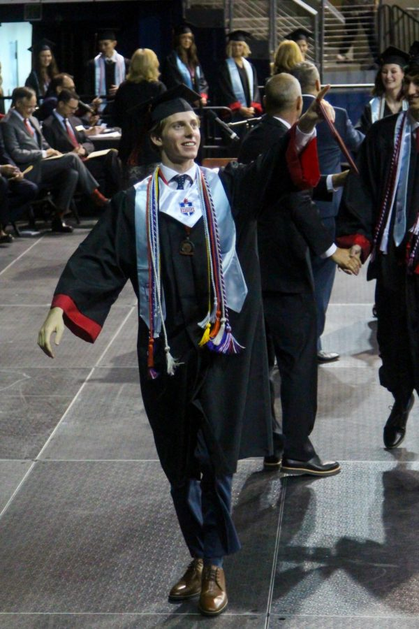 Graduate Luke Hopkinson points to his family after receiving his diploma. Hopkinson will be attending Purdue University in the fall.
