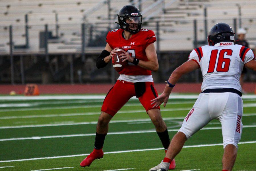 Junior quarterback no. 12 Brandon Hagle gets ready to throw the ball. The pass was completed to senior receiver no. 3 Omari Murdock.