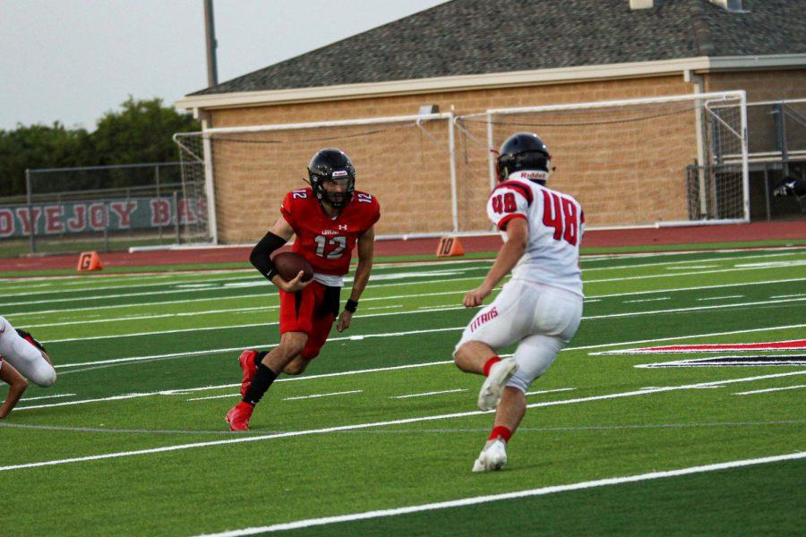 Junior quarterback no. 12 Brandon Hagle runs the ball. The Leopards will play Bryan in a non-district game on Friday.