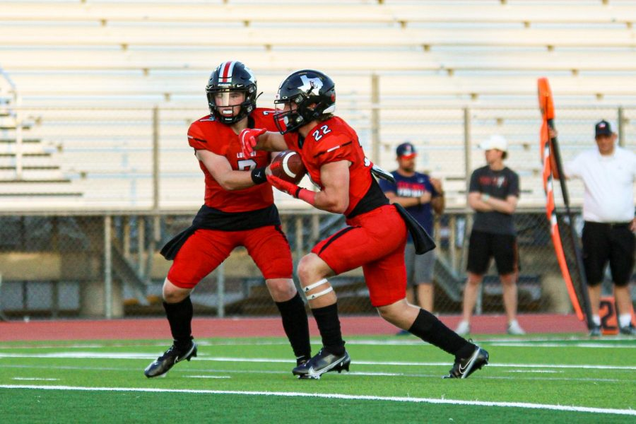 Sophomore quarterback no. 7 Alexander Franklin hands the ball off to sophomore running back no. 22 Matthew Mainord. The Leopard's first district game will be played next Friday against Sulfer Springs.