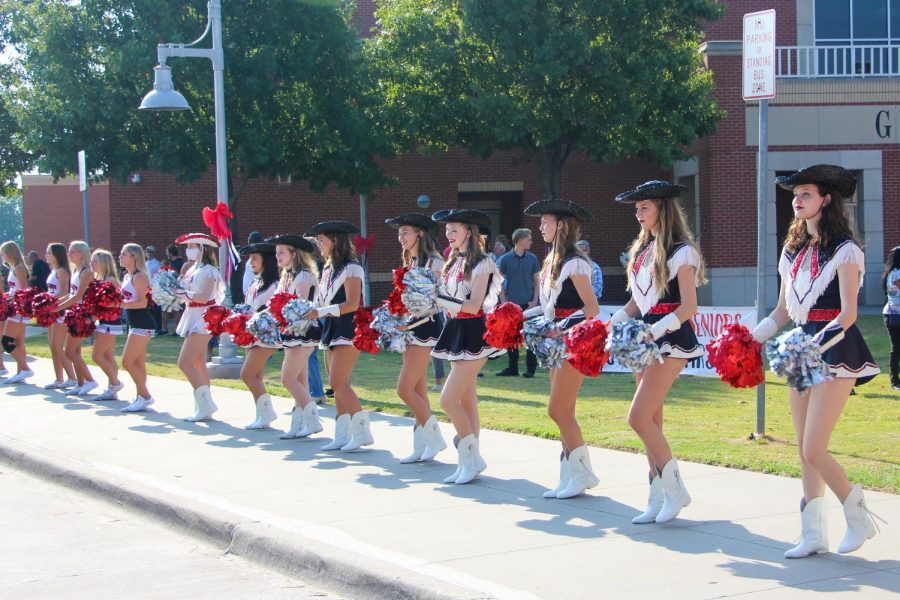 The Majestics and cheer teams cheered on the seniors before they walked through the leopard head. The drumline also participated in the senior walk.