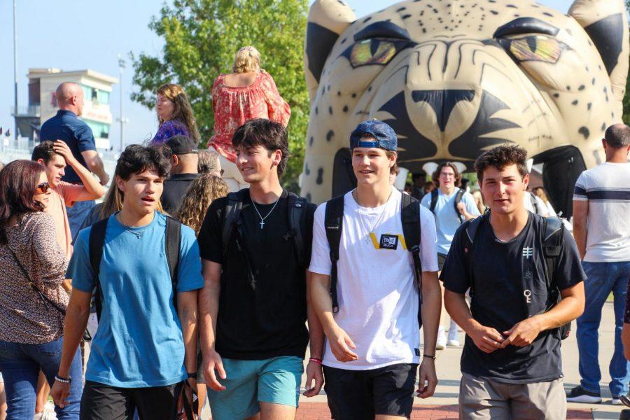 Seniors Sebastian Vizcaino, Garrett Falk, Ethan Williams, and Nico Aguilar walk to the school together. Falk is on the tennis team.
