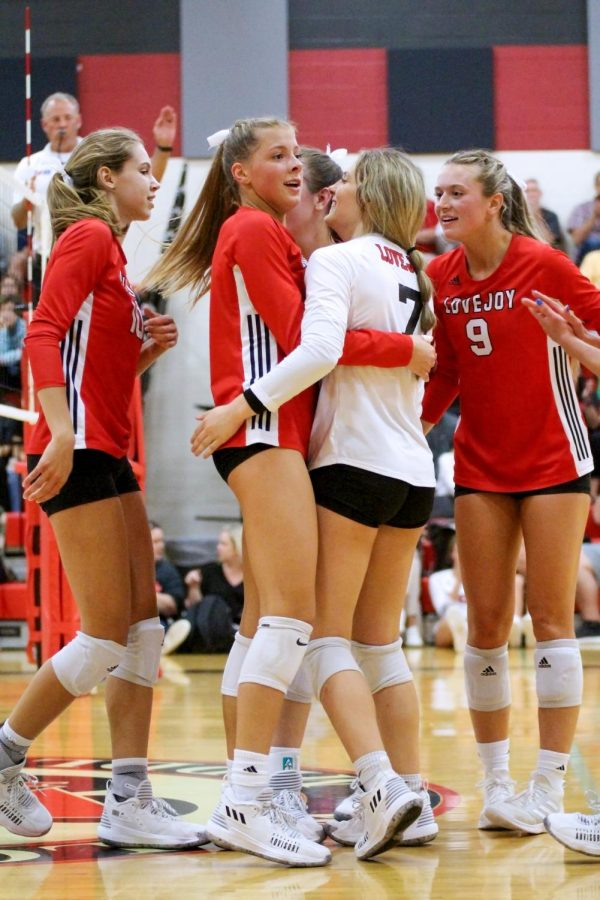 Senior setter no. 17 Rosemary Archer, senior libero no. 7 Ava Camacho, senior setter 9 Averi Carlson, and senior middle hitter no. 10 Grace Milliken celebrate after getting a kill. That score took the game to 25-13 to win the third set.