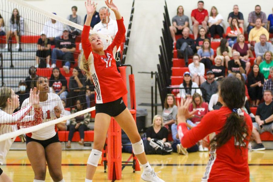 Senior setter no. 17 Rosemary Archer sets the ball to junior hitter no. 12 Hannah Gonzalez. The Leopards won the first set 25-20.