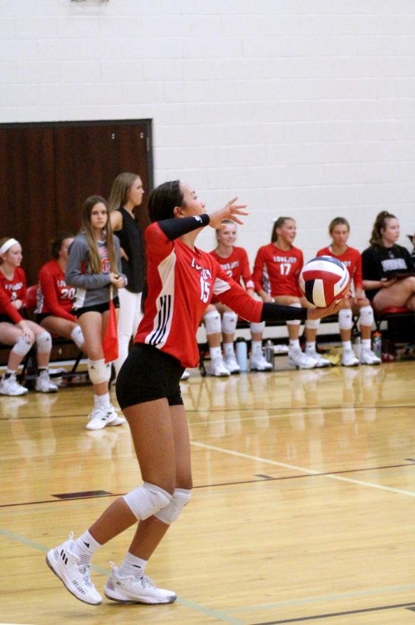 Sophomore setter no. 15 Bethanie Wu serves the ball to a Braswell player. The Leopards won the second set 25-11.