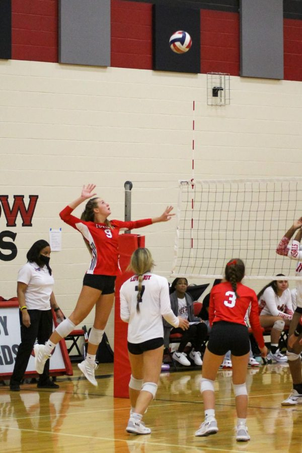 Senior setter no. 9 Averi Carlson hits back to Denton Braswell. Carlson is committed to play at Baylor University.