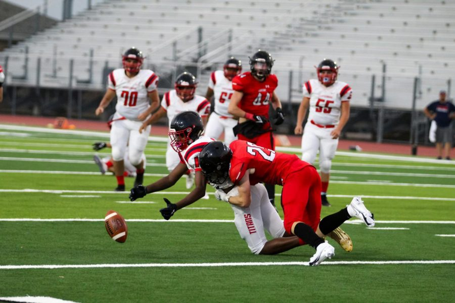 Junior safety no. 29 Thomas Harp tackles Centennials running back. The Leopards scored a total of 54 points.