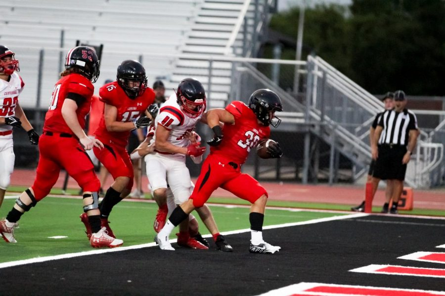 Junior running back no. 30 Mason Wallace scores a touchdown. The Leopards had a complete shutout against Centennial.
