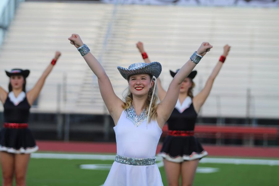 Senior Majestic captain Mackenzie Aubel poses with her hands in the air. Aubel is the captain of the Majestics.