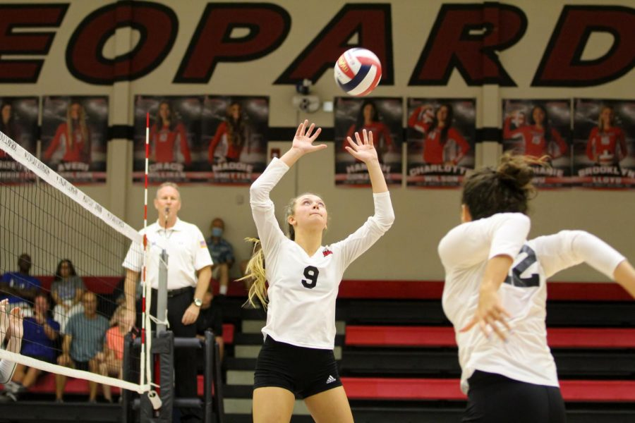 Senior setter no. 9 Averi Carlson sets the ball to junior middle hitter no. 12 Hannah Gonzalez. Carlson's set to Gonzalez was complete, giving the Leopards a score of 15-8 in the first set.