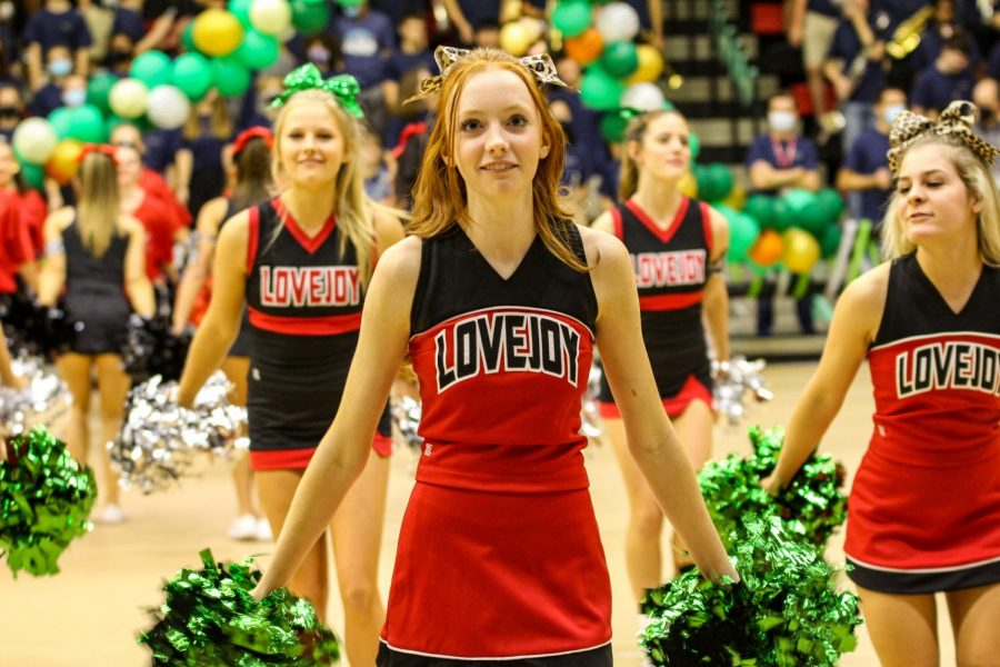 """Senior Claire Traylor cheers to the Leopard Rumble at the pep rally. The theme of the pep rally was """"Welcome to the Jungle."""""""