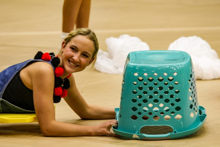 Senior Tatum Chester pulls the laundry basket as she plays the pep rally game. Chester and her partner Derek Dang won the game that was played by each grade.