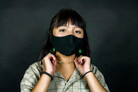 Freshman Amelie Vuong wears pieces of jewelry she made. Vuong