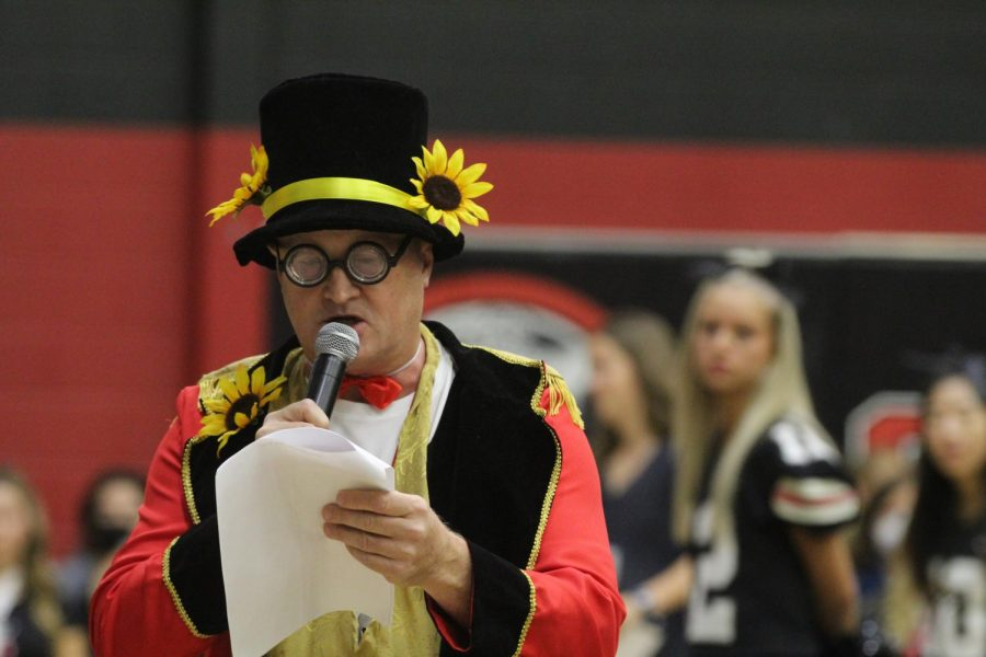 Animation teacher Ray Cooper opens the pep rally. Cooper co-hosted with superintendent Katie Cordell.