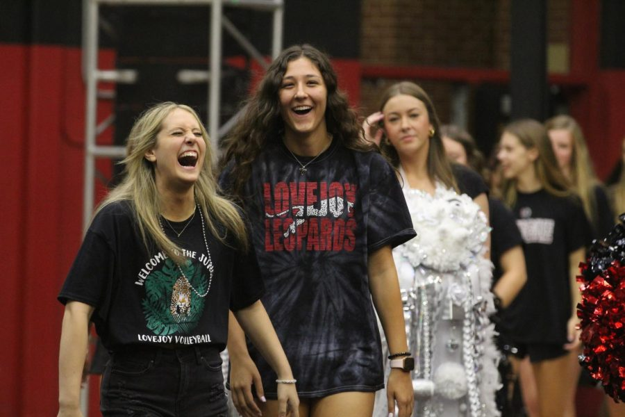 Senior Ava Comacho and junior Hannah Gonzalez walk into the gym. The volleyball team announced their next game being played in Princeton.