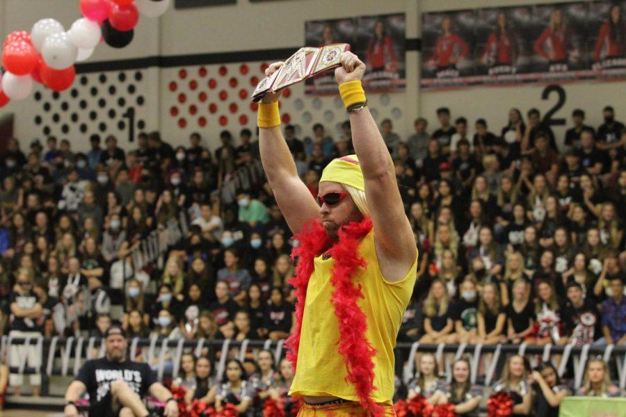 Chemistry teacher Jared Glaze puts up the WWE wrestling belt. Glaze was quickly eliminated.