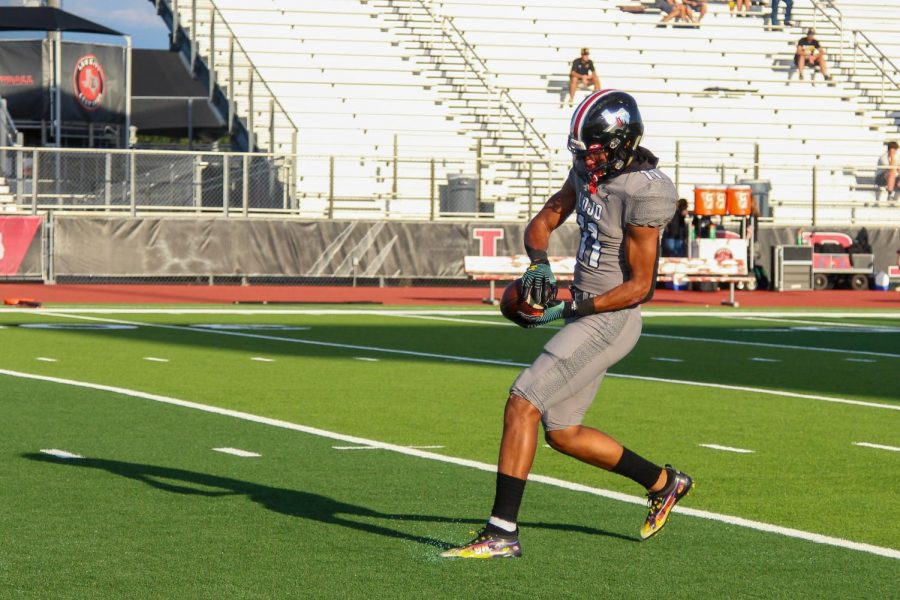 Senior wide receiver no. 11 Omari Murdock catches the ball during warm-ups. The Leopards are currently in their bye week.