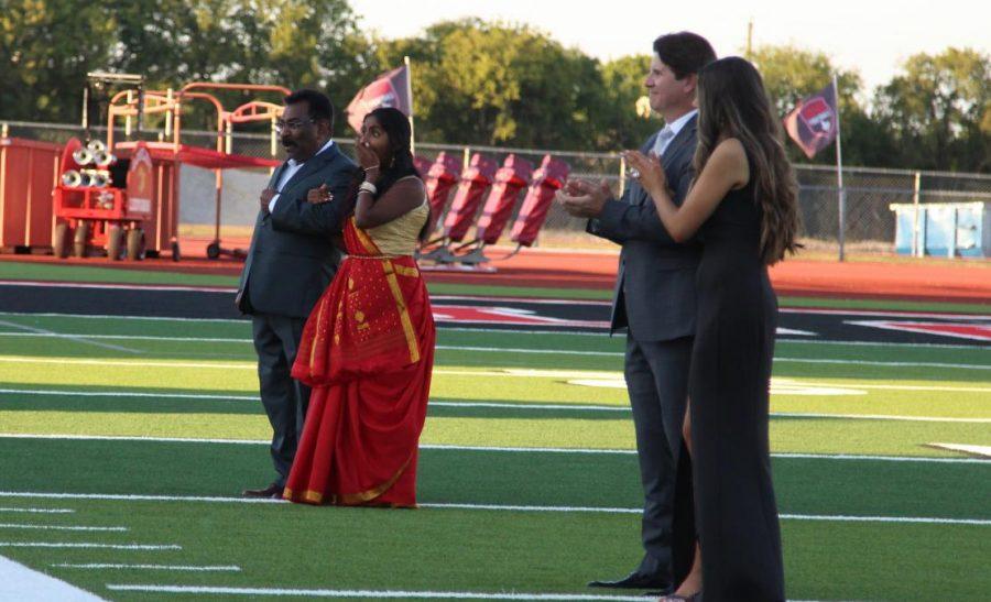 Senior Dinah Thatikonda reacts to her name being called as homecoming queen. Senior Derek Dang won homecoming king.