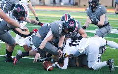 Senior middle linebacker no. 23 Dillon Magee recovers the ball. The recovery was after a forced fumble.