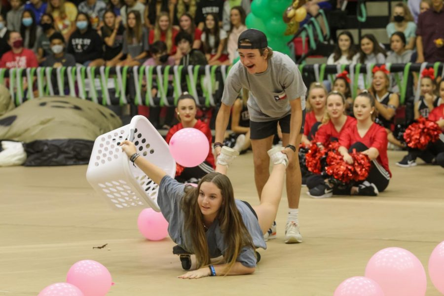 """Freshman Sophie Stein and freshman Ryland Streeter participate in the game, """"Hungry Hippos."""" The pep rally game was a crowd favorite."""
