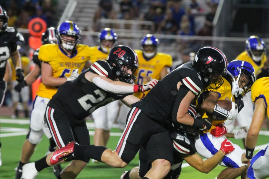 Senior linebacker no. 20 Philip Joest and sophomore no. 7 linebacker Payton Pierce tackles a Sulphur Springs offensive player.  The score was 51-0 at half time.