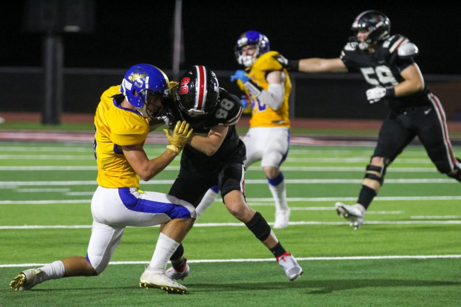Sophomore wide receiver no. 88 Colgin Pettit attempts to tackle senior wide receiver no. 6 Colby Albritton. The game finished with a final score of 71-7.