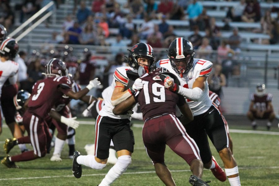 Junior wide receiver no. 2 Jaxson Lavender and senior wide receiver no. 11 Omari Murdock tackle Princeton's senior outside linebacker no. 19 Donovan Dixon. The game concluded with a score of 69-21.