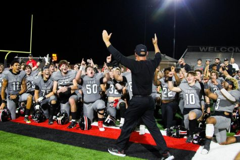 The team gets hyped up as Coach Chris Ross walks over to them. The next game will be played against Rock Hill next Friday.
