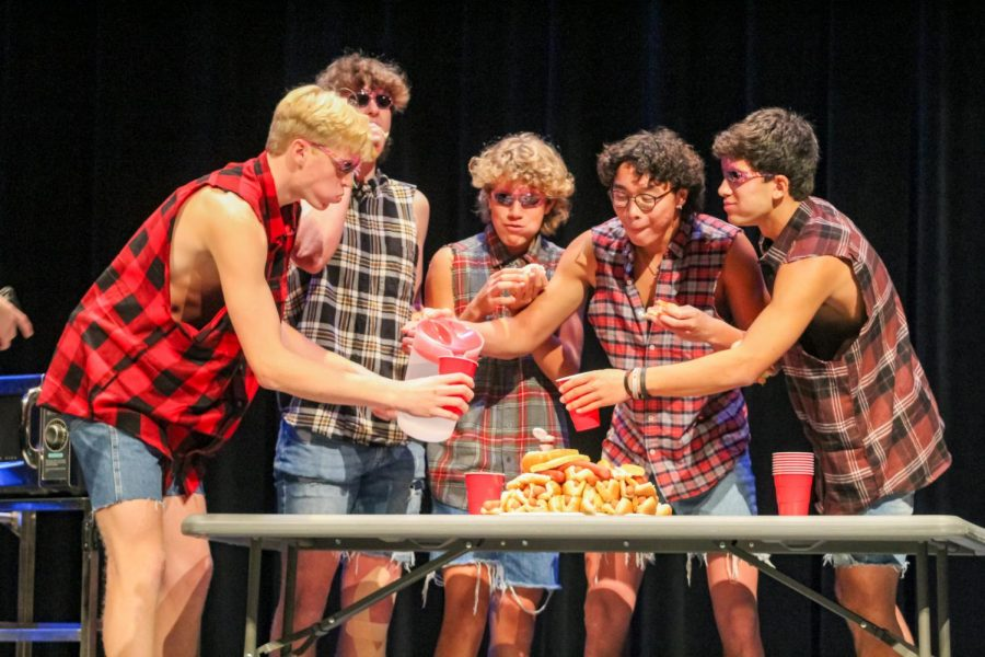 Senior Derek Dang attempts to eat as many hot dogs as he can. Dang's hot dog contest was a crowd favorite.