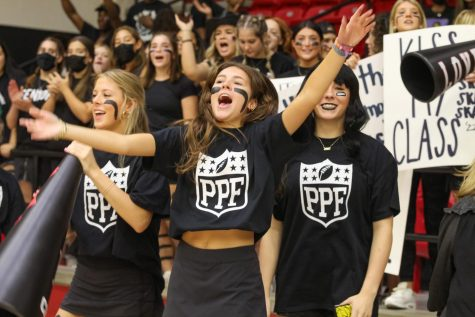 Senior Gia George cheers on the senior powderpuff team. Powderpuff is an annual homecoming tradition at the high school.