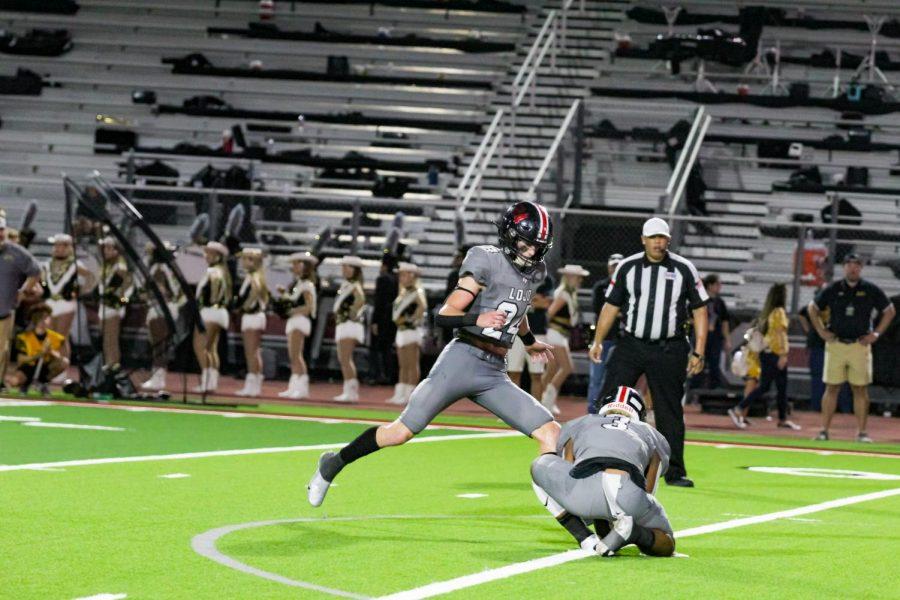 Senior defensive back no. 24 Trent Rucker kicks the ball. Rucker's kick was complete after junior wide receiver no. 2 Jaxson Lavender scored a touchdown.