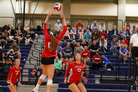 Senior setter no. 17 Rosemary Archer sets the ball up to junior hitter no. 12 Hannah Gonzalez. The Leopards went into overtime as the score was equal at the end of the first set.