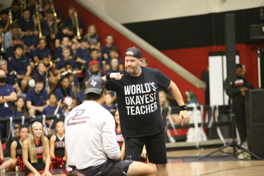 Yearbook adviser and photojournalism teacher Aaron Cappotelli threatens football coach Riley Donovan before the musical chairs game. Donovan won the musical chairs game.