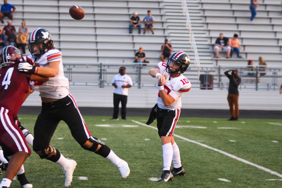 Sophomore quarterback no. 10 Alexander Franklin makes a pass. The pass was complete to junior wide receiver no. 2 Jaxson Lavender.