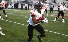 Junior wide receiver no. 4 Kyle Parker runs the ball down the sideline. Parker received for a total of 91 yards.