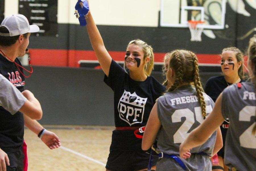 Senior Khloe Litchenburg holds up a flag she grabbed off of a freshmen. The seniors beat the freshmen in the first game.